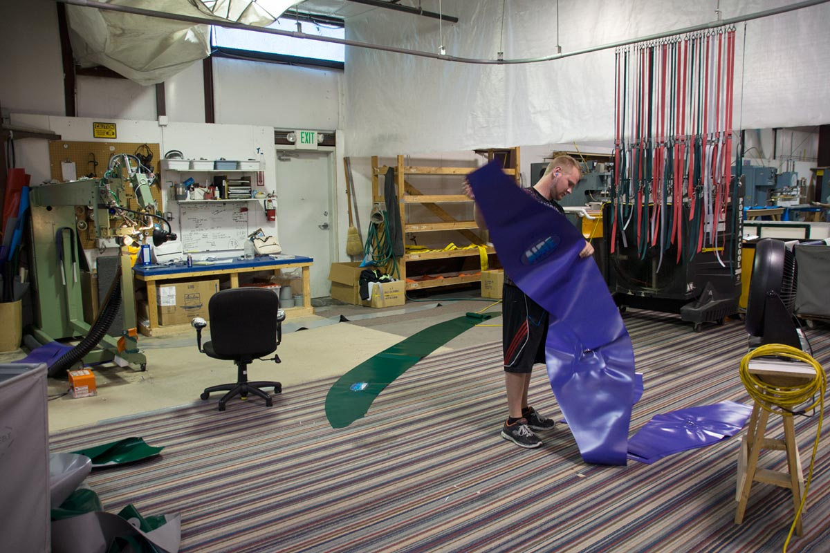 AIRE Raft Employee Prepares Fabric Material