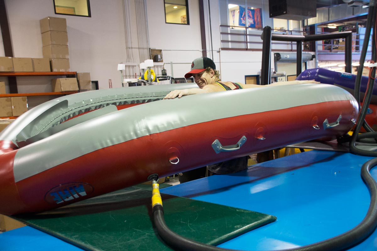 AIRE Red Super Puma Raft Inflated Hull Being Inspected