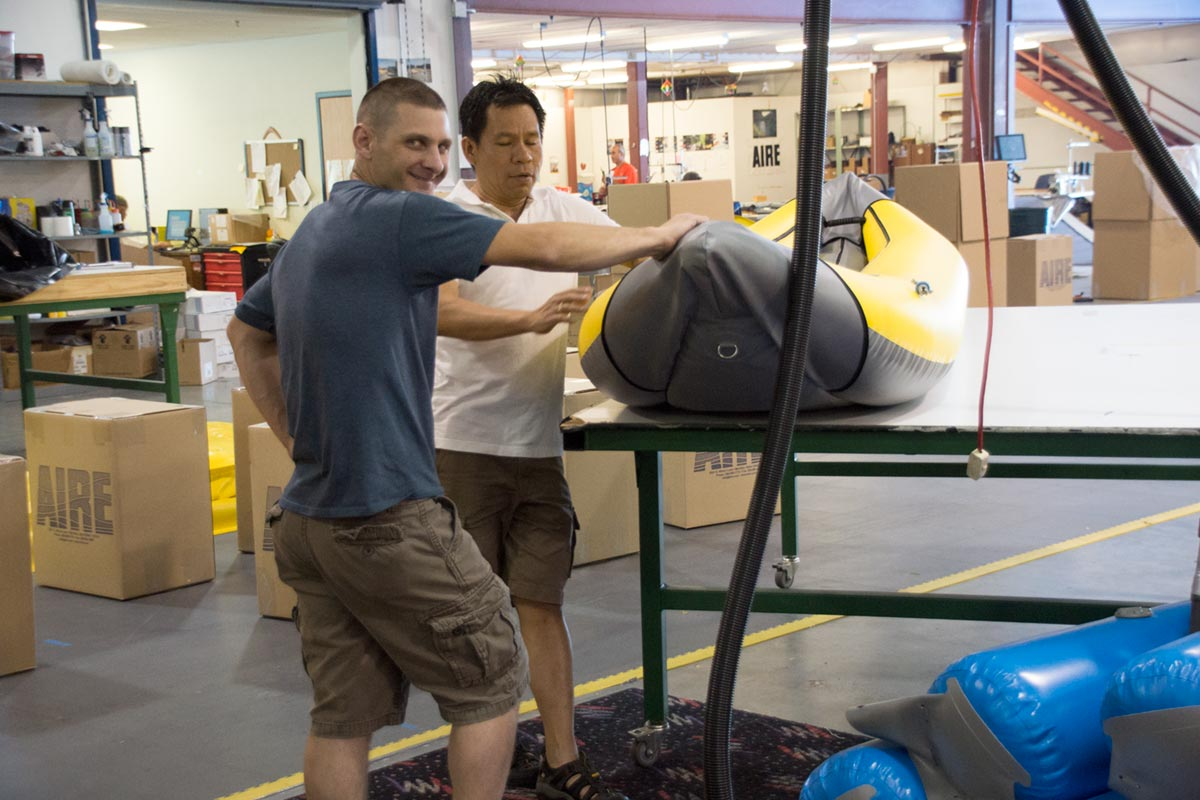 AIRE Craftspersons Inspect and Discuss Nearly Finished Inflatable Kayak